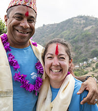 """NAMOBUDDHA, NEPAL (05/26/2019)-Salil and Emily Mehta, from San Francisco, during a Habitat for Humanity Global Village trip in Namobuddha, Nepal. """"These trips bring out the best in you."""", says Salil.  """"It's our thing. Giving back has strengthened our relationship, helped define our commitment to the world. Habitat is our outlet. It's important to both of us."""" ©Habitat for Humanity International/Jason Asteros"""